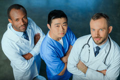 Multiracial group of doctors standing in row in clinic. High angle view of multiracial group of doctors standing in row in clinic Stock Photography