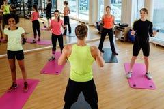 Multiracial group doing aerobics exercise Stock Photo