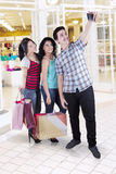 Multiracial group of friends taking photo in mall Royalty Free Stock Photography