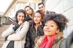 Multiracial group of friends taking selfie Stock Images