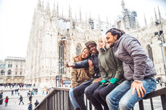 Multiracial group of friends taking selfie in Milan Royalty Free Stock Images