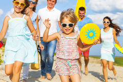 Multiracial group of friends walking at the beach Royalty Free Stock Images
