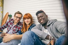 Multiracial group taking selfie Stock Images