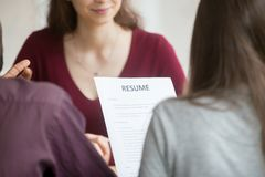 Multiracial hr managers holding reading candidates resume during Stock Photo