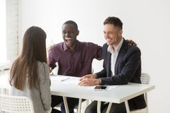 Multiracial hr managers laughing at funny joke interviewing woma. Multiracial hr managers laughing at funny humor joke during job interview talking to women Royalty Free Stock Photos