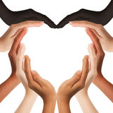 Multiracial human hands making a heart shape