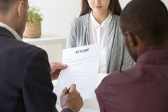 HR managers reading female employee resume in office royalty free stock images