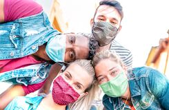 Free Multiracial Millenial Friends Taking Selfie Smiling Behind Face Masks - Happy Friendship And New Normal Concept With Young People Stock Image - 187083751