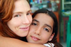 Multiracial mother and daughter family hug. Multiracial american mother and daughter family hug Stock Photography