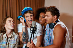 Multiracial music band performing in a recording studio Stock Photography