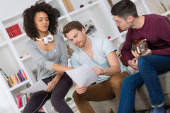 Multiracial music band rehearsing in recording studio. Multiracial music band rehearsing in a recording studio royalty free stock images