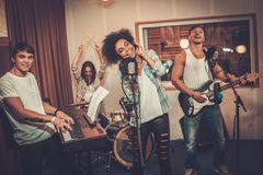 Multiracial music band in a studio Stock Photo