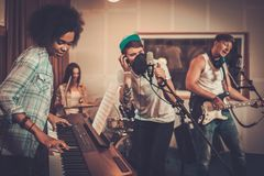 Multiracial music band in a studio Stock Images