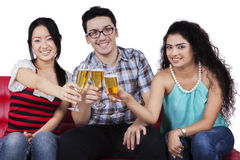 Multiracial people enjoy champagne and toasts together Royalty Free Stock Images