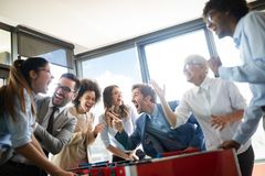 Multiracial people having fun in office room, excited diverse employees enjoying activity at work. Multiracial team people having fun in office room, excited stock image