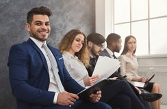 Multiracial people waiting in queue preparing for job interview. Multiethnic people waiting in queue. preparing for job interview, unemployed vacancy applicants royalty free stock photography
