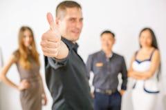 Multiracial pomyślni ludzie biznesu z aprobata gestem fotografia stock