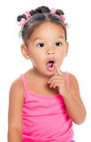 Multiracial small girl with a funny inquisitive expression Stock Images