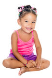 Multiracial small girl laughing sitting on the floor Royalty Free Stock Photos