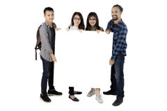 Multiracial students holds blank banner Royalty Free Stock Images