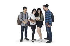 Multiracial students with tablet on studio Stock Images