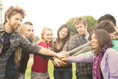 Multiracial Students whit hands on stack stock photography