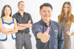 Multiracial successful business people with thumbs up gesture Stock Image