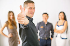 Multiracial successful business people with thumbs up gesture Stock Photography
