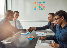 Multiracial team concluding a business agreement Royalty Free Stock Images