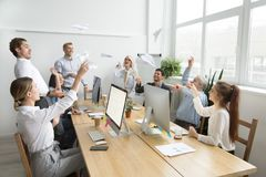 Multiracial team of young and senior people launching paper plan royalty free stock images
