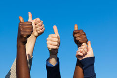 Multiracial Thumbs Up. Against Blue Sky Royalty Free Stock Photos