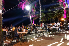Multiracial tourists at Boracay beach by night. BORACAY, PHILIPPINES - 12 FEBRUARY 2016: multiracial tourists chilling at beach restaurant bar in Boracay Royalty Free Stock Photos