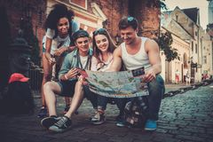 Multiracial tourists in an old city Royalty Free Stock Photography