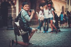 Multiracial tourists in an old city Stock Image
