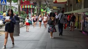 Multiracial tourists walking on Orchard Road. Singapore - January 08, 2018: crowded multiracial tourists walking on the Orchard Road Singapore stock footage