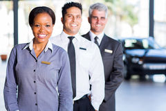Multiracial vehicle sales team. Inside car showroom Stock Images