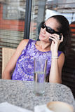Multiracial woman on phone Stock Images