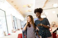Multiracial women in the diner. Two young women socializing in the diner Stock Photos
