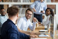 Multiracial work team having fun and laughing together royalty free stock photos