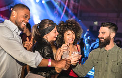 Multiracial young friends dancing at night club - Happy people Royalty Free Stock Image