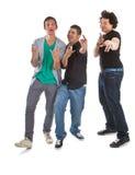 Multiraciale tieners die over wit worden geïsoleerde Royalty-vrije Stock Foto