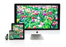 Multiscreen - ρολόι της Apple, iPhone, iPad και iMac Στοκ Φωτογραφία