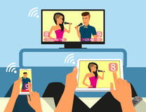 Multiscreen interaction. Man and woman are Stock Photos