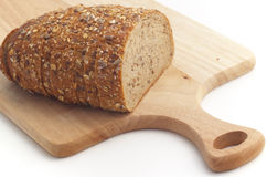 Multiseed bread on wooden board. Multiseed bread on wooden cutting  board Royalty Free Stock Photo