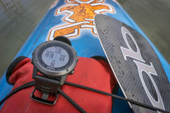 Multisport Garmin GPS watch on paddleboard Stock Photography