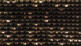 Multistorey block of flats at night Stock Images
