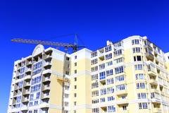 Multistorey modern house with hoisting crane Royalty Free Stock Image