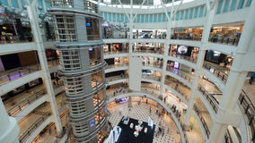 Multistorey shopping mall with customers royalty free stock photography