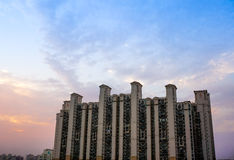 Multistoreyed building in Gurgaon with cloudy colorful sky. Multistoreyed apartments in Gurgaon India against a colorful cloudy sky Stock Image