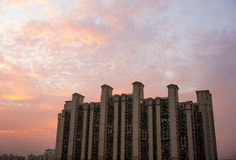 Multistoreyed building in Gurgaon with cloudy colorful sky. Multistoreyed apartments in Gurgaon India against a colorful cloudy sky Stock Photography